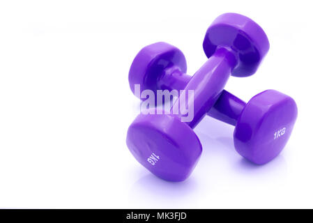 Colourful hand weights isolated on a white background with copy space. - Stock Photo