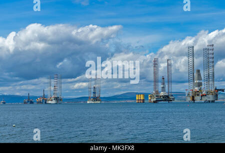 CROMARTY FIRTH SCOTLAND DECOMMISSIONED OIL RIGS WITH TALL SUPERSTRUCTURE LYING OFF CROMARTY