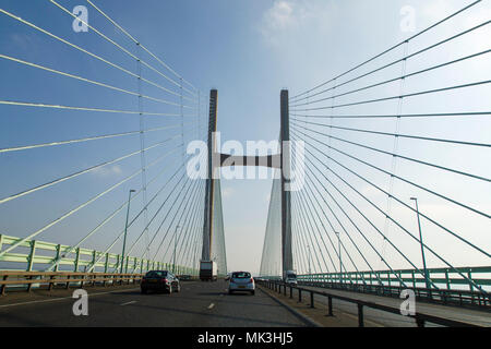Chepstow, UK: February 24, 2018: Crossing the Severn Bridge eastward bound. Following traffic across the Severn River into England. - Stock Photo