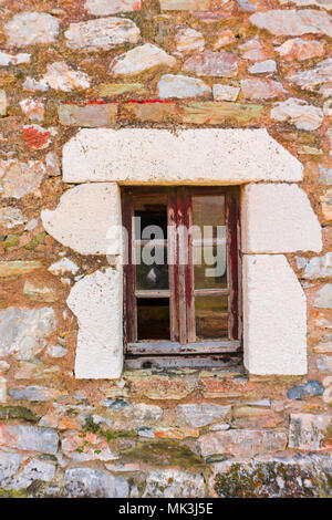 Traditional window of an abandoned house tower in Mani Greece - Stock Photo