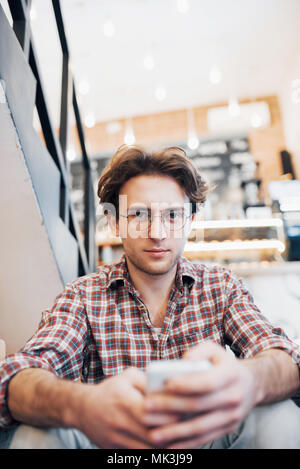 Man drinking a cup of coffee in the cafe - Stock Photo