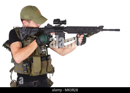 Private military contractor - rifleman with assault rifle isolated on white - Stock Photo
