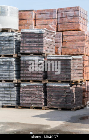 new bricks on pallets. pallets with bricks in the building store. Racks with brick. Masonry, stonework. - Stock Photo