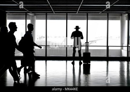 Passengers inside airport - Stock Photo