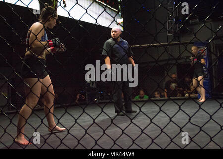 Danae Dostie, a specialist with the Maine Army National Guard 488th Military Police Company makes her mixed martial arts debut against the youngest MMA fighter in New England Fights history at Aura nightclub in Portland, November 3rd in an amateur bantamweight (135-pound) contest against Jayda Bailey.   'If you want it you have to go out and get it,' said Dostie. 'It's definitely not a walk in the park. You will need drive and motivation.' - Stock Photo