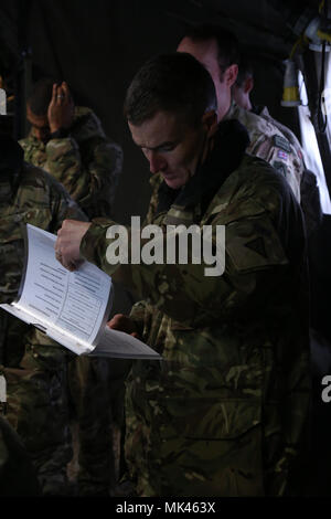 British army Warrant Officer Class 1 Kevin Brunskill of the 1st Battalion, Royal Regiment of Fusiliers reviews mission information while conducting a back brief during exercise Allied Spirit VII at the U.S. Army's Joint Multinational Readiness Center in Hohenfels, Germany, Nov. 5, 2017. Approximately 4,050 service members from 13 nations are participating in exercise Allied Spirit VII at 7th Army Training Command's Hohenfels Training Area, Germany, Oct. 30 to Nov. 22, 2017. Allied Spirit is a U.S. Army Europe-directed, 7ATC-conducted multinational exercise series designed to develop and enhanc - Stock Photo