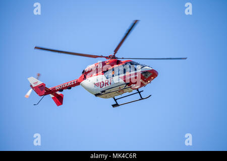 DELMENHORST / GERMANY - MAY 06, 2018: Eurocopter BK-117 from DRF Luftrettung flies over landing side. Notarzt means emergency doctor. - Stock Photo