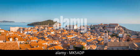Panoramic view of the old town of Dubrovnik in beautiful golden evening light at sunset with blue sky in summer, Dalmatia, Croatia - Stock Photo