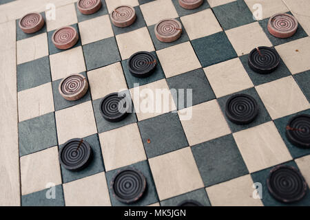 checkers game in public on sidewalk, step up and take a seat to play the game with a friend or stranger - Stock Photo