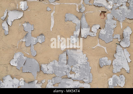 Close-up weathered and stained obsolete concrete wall texture. Old detailed beige surface with cracked paint layer - Stock Photo