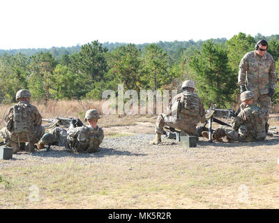 Soldiers assigned to 5th Battalion, 1st Security Force Assistance Brigade fire .50 caliber machine guns at a firing range Nov. 2, 2017, at Fort Benning, Ga. Soldiers interested in SFAB opportunities should contact their branch manager for more information. (U.S. Army photo by Sgt. Arjenis Nunez/Released) - Stock Photo
