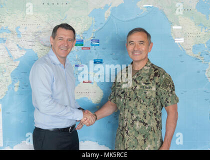 CAMP SMITH, Hawaii (Nov. 9, 2017)- Commander, U.S. Pacific Command (USPACOM) Adm. Harry Harris shakes hands with Chief Minister of Australia's Northern Territory, Michael Gunner, before a meeting at USPACOM headquarters.  During the meeting, Admiral Harris thanked Chief Minister Gunner for his support to U.S. Marines deployed to Darwin and U.S. Air Force interoperability with the Royal Australian Air Force as part of the Enhanced Air Cooperation initiative.  The 2017 rotation of Marines in Darwin was the sixth deployment to the Northern Territories and concluded in October 2017.  (U.S. Navy ph - Stock Photo
