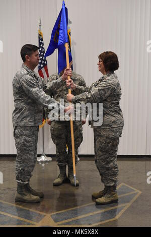Pennsylvania Air National Guardsman, Colonel Mark Goodwill, Mission Support Group Commander, left, presents Lt. Col. Angela Stateler, right, the 171st Force Support Squadron during her Assumption of Command Ceremony at the 171st Air Refueling Wing near Pittsburgh, Pennsylvania Nov. 4, 2017. (U.S. Air National Guard Photo by Senior Master Sgt. Shawn Monk) - Stock Photo
