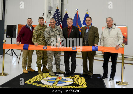 Maj. Gen. Tony Carrelli, Pennsylvania's adjutant general, cuts the ribbon dedicating the Eastern Army National Guard Aviation Training Site's (EAATS) new Aviation Maintenance Instructional Building (AMIB) Nov. 13 at Fort Indiantown Gap. From left to right, Doug Boltz, general manager of Senate Builders, Lt. Col. Todd Tuttle, EAATS commander, Carrelli, Pa. state rep. Russ Diamond, Robert DeSouza, state director for U.S. Sen. Pat Toomey, and Bruce Shapiro, chief operating officer at Boro Construction joined in the ceremony. (U.S. Army National Guard photo by Sgt. Zane Craig) - Stock Photo