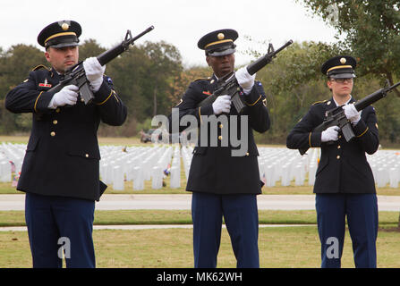 JOINT BASE SAN ANTONIO, Texas — Soldiers of the Military Funeral Honors Caisson Detachment here conduct an eight-man rifle salute during Caisson Funeral Honors (Fallen Stars) for Gen. (Ret.) Richard E. Cavazos at the Fort Sam Houston National Cemetery, Nov. 14. (U.S. Army photo by Sgt. Christopher Hernandez, Army North Public Affairs) - Stock Photo