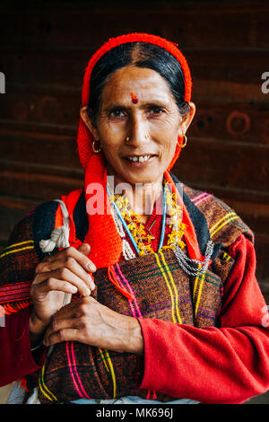 Nagar, Himachal Pradesh, India :  Portrait of Himachali woman in colourful dress outside the Murlidhar Krishna temple in the historical town of Naggar - Stock Photo