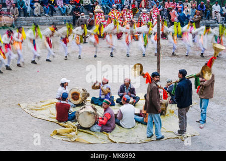 Naggar, Himachal Pradesh, India : During the Naggar Mela festival musicians perform sitting on the floor while high caste rajputs dance in a circle in - Stock Photo