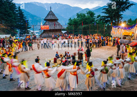 Nagar, Himachal Pradesh, India : During the Naggar Mela festival high caste rajputs dance in circles in honor of the local deity Tripura Sundari outsi - Stock Photo