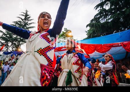 Nagar, Himachal Pradesh, India : During the Naggar Mela festival Himachali women dance in honor of the local deity Tripura Sundari outside her temple  - Stock Photo