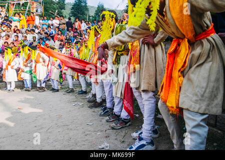 Nagar, Himachal Pradesh, India : During the Naggar Mela festival  rajput dancers with handkerchiefs in their hands dance in honor of the local deity T - Stock Photo