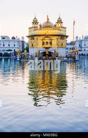 Amritsar, Punjab, India : Golden Temple reflected on the surrounding Amrit Sarovar (Pool of Nectar). - Stock Photo