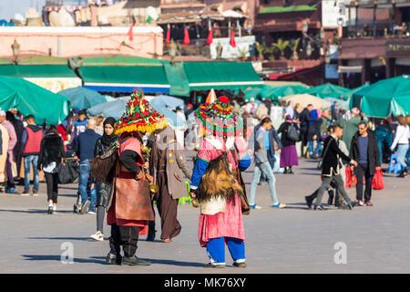 MARRAKESH, MOROCCO - DECEMBER 17, 2017: Colorful water bearer in Marrakech, Morocco. - Stock Photo