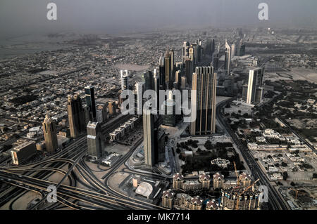 Panorama sunset view to Dubai skyscrapers in UAE - Stock Photo