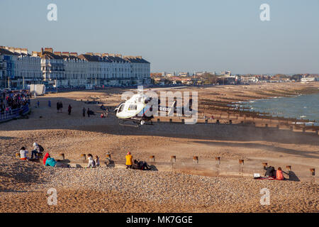 Eastbourne Sussex UK May 5th 2018: Air Ambulance lands on Eastbourne seafront  an accident between a car & cyclist in the Town Centre - Stock Photo