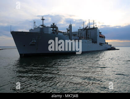 171114-N-OH262-110  NORFOLK, Va. (Nov. 14, 2017) The Lewis and Clark-class dry cargo and ammunition ship USNS Medgar Evers (T-AKE 13) pulls into Naval Station Norfolk. Medgar Evers returned to Norfolk after  completing its overseas deployment in support of U.S. Navy and allied forces operating in the U.S. 6th Fleet's area of operations. (U.S. Navy photo by Bill Mesta/released) - Stock Photo