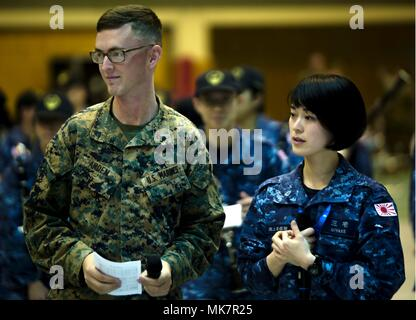Japan Maritime Self-Defense Force Band member Yukari Miyake performs with U.S. Marine Cpl. Ivan Arden, a Chicago native, Nov. 13, 2017, during the Japan Self-Defense Force Marching Band Festival at Camp Asaka, Japan. The festival brings military bands from the U.S., Thailand, and Japan to perform together and bond through music. Miyake, from Kurashiki, is a vocalist with the JMSDF Band. (U.S. Marine Corps photo by Cpl. Andrew Neumann) - Stock Photo