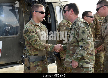 U.S. Army Soldiers with Task Force Marauder were presented with coins from U.S. Air Force Gen. Joseph Lengyel, Chief, National Guard Bureau, Nov. 23, 2017 in Afghanistan for their recent actions in response to a mass casualty involving U.S. Soldiers. Lengyel recognized Soldiers with Detachment 1, C Company, Medical Evacuation, 2-211th General Support Aviation Battalion (GSAB) with the Iowa National Guard and C Company, 4-3 Assault Helicopter Battalion (AHB), 3rd Combat Aviation Brigade, who responded to a vehicle borne improvised explosive device strike against an American convoy Nov. 13, 2017 - Stock Photo