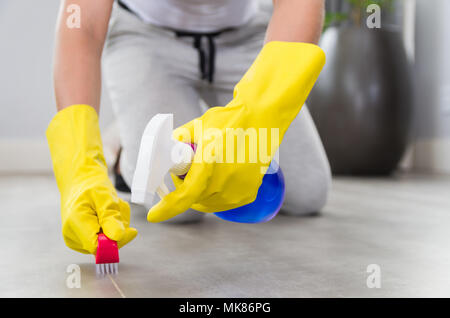 Great concept of domestic cleaning, woman cleaning the floor. - Stock Photo