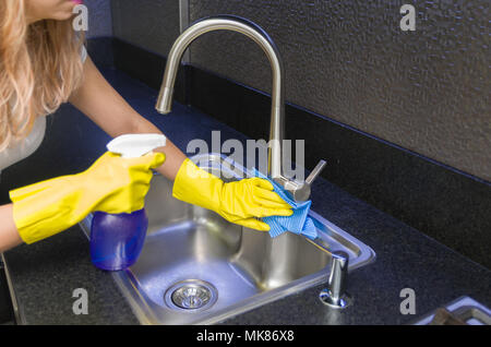 Great concept of domestic cleaning, woman cleaning the sink - Stock Photo