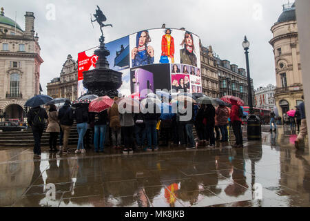 Wet weather in Central London brings out lots of umbrellas - the great British summer - Stock Photo