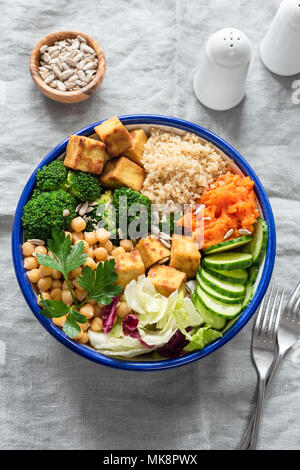 Colorful buddha bowl, healthy vegetarian salad. Buddha bowl with broccoli, quinoa, chickpeas and vegetables. Healthy lifestyle, healthy eating, dietin - Stock Photo