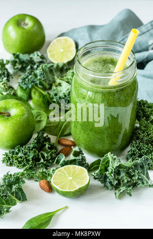 Green detox smoothie or blended juice in glass bottle on white. Smoothie with kale, broccoli, spinach, apple and lime. Green smoothie bottle. Concept  - Stock Photo