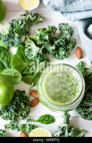 Smoothie detox with green fruits, vegetables, spinach and kale on white. Green smoothie and ingredients. Top view, selective focus - Stock Photo