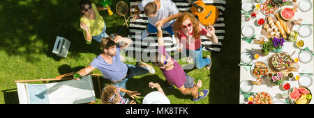 Young people having fun at summer barbeque party - Stock Photo