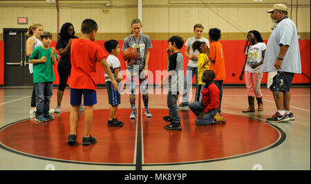 ... Children participating in the Hoops for Hunger basketball games prepare  to start the game in Sam s 2b67113a9
