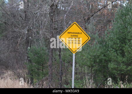 A sign provides warning to drivers at a low-water crossing Nov. 28, 2017, on Silver Creek on South Post at Fort McCoy, Wis. The sign warns drivers to not use the crossing if water levels are too high. (U.S. Army Photo by Scott T. Sturkol, Public Affairs Office, Fort McCoy, Wis.) - Stock Photo
