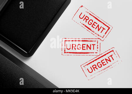 Multiple Urgent stamps on white background. - Stock Photo