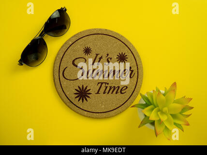 It's Summer Time. Cork board, sunglasses and potted plant on yellow background. - Stock Photo