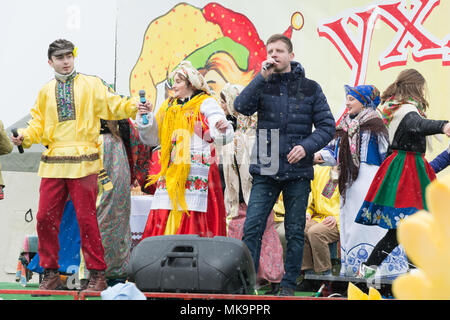 TIRASPOL, MOLDOVA - FEBRUARY 18, 2018: The man is singing at the Maslenitsa festival. In the folk calendar of the Eastern Slavs, the holiday marks the - Stock Photo
