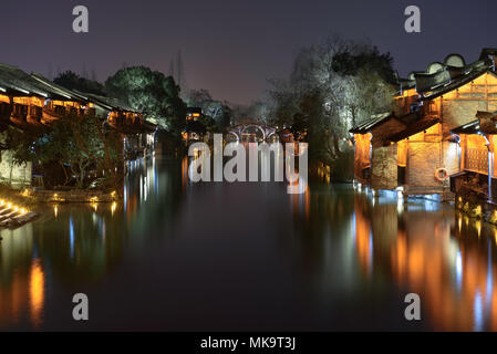 Night view of the ancient building by the water in Wuzhen. Wuzhen - historic ancient water town, part of Tongxiang, located in northern Zhejiang Provi - Stock Photo