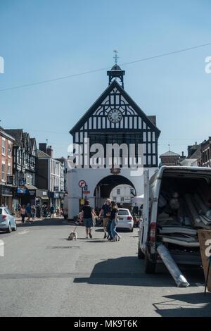 People walking around English market town of Bridgnorth on a warm Spring day enjoying the sunshine - Stock Photo