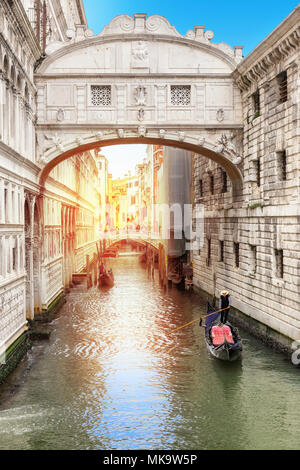 bridge of sighs in Venice and Venetian gondola on green canal, Venice, Italy. - Stock Photo
