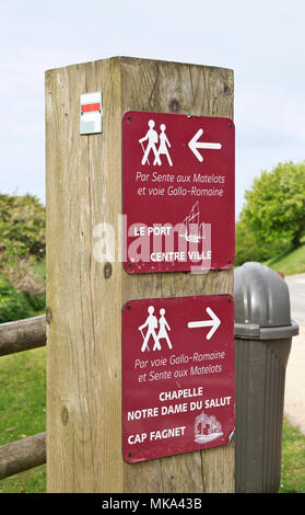 A wooden sign post on a footpath giving directions . Fecamp. Normandie, France - Stock Photo