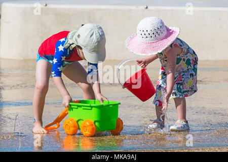 Bournemouth, Dorset, UK. 7th May 2018. UK weather: Children cooling down playing in the water feature at Pier Approach on a hot and sunny May Bank Holiday Monday. Credit: Carolyn Jenkins/Alamy Live News - Stock Photo