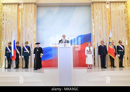 Moscow, Russia. 07th May, 2018. MOSCOW, RUSSIA - MAY 7, 2018: Russian Constitutional Court Chairman Valery Zorkin (4th L), Russian Federation Council Chairperson Valentina Matviyenko (4th R), Russia State Duma Chairman Vyacheslav Volodin (3rd R) look on as President-elect Vladimir Putin (C) being sworn-in as President of Russia in St Andrew's Hall of the Grand Kremlin Palace. Alexei Druzhinin/Russian Presidential Press and Information Office/TASS Credit: ITAR-TASS News Agency/Alamy Live News - Stock Photo