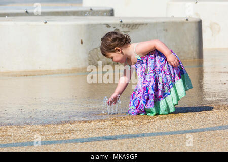 Bournemouth, Dorset, UK. 7th May 2018. UK weather:  Young girl cooling down playing in the water feature at Pier Approach on a hot and sunny May Bank Holiday Monday. Credit: Carolyn Jenkins/Alamy Live News - Stock Photo